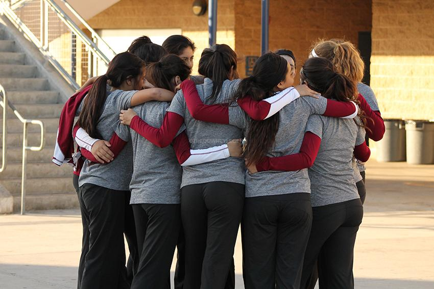 """Before the Downey vs. Warren game on Wednesday, Oct. 8 the varsity volleyball girls huddled outside the gym. """"It's that time of the year again; let's beat those Bears!"""" Schanrs said, """"We can do this girls!"""""""
