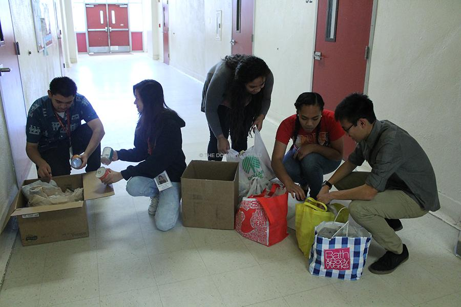 """In the S building, ASB students go to classrooms and collect all canned items for the annual food drive on Thurs., Nov. 14. """"We [can] eliminate hunger,"""" junior, Leni Makaafi said."""
