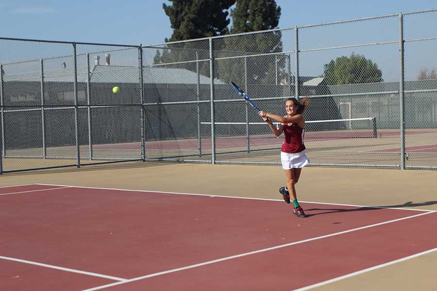 On Oct. 22, Lauren Martinez, 11, plays against Paramount during their last tennis game of the season at the Downey courts.  Martinez ranked second in singles tournament.
