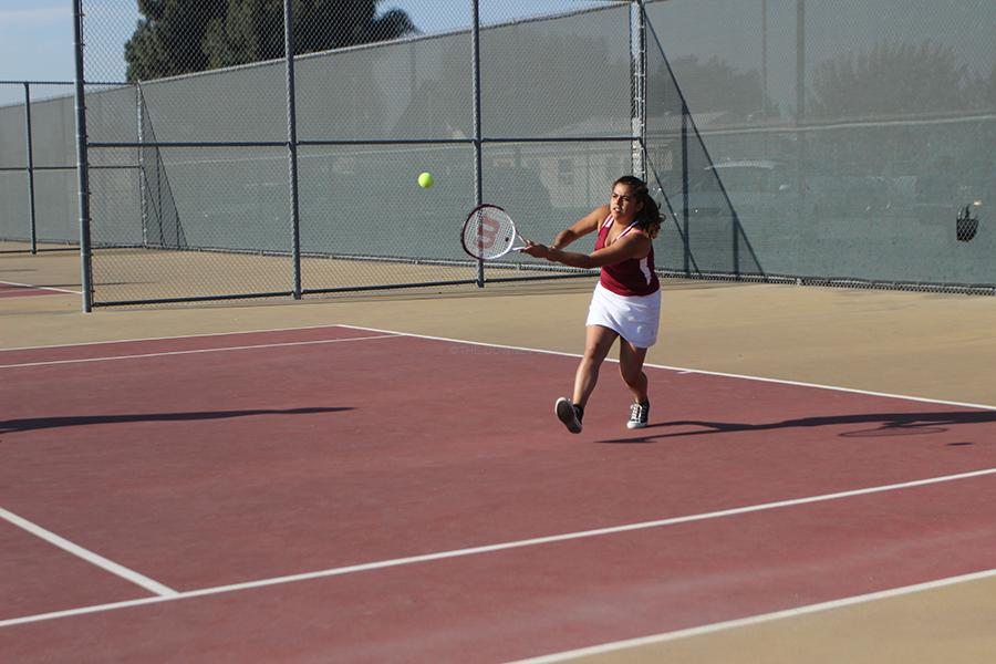 On Oct. 22, Kathy Ochoa returns a serve during last game of the season vs. Paramount. The tennis team ended up winning 11 to 7.