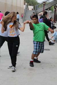 """On Thursday, Oct. 24, Tailer Villarreal, 10, dances with Luis Rodriguez,11, at the third annual amigos barbeque. """"They're so sweet,"""" Villarreal said. """"I always have fun dancing with the Amigos."""""""