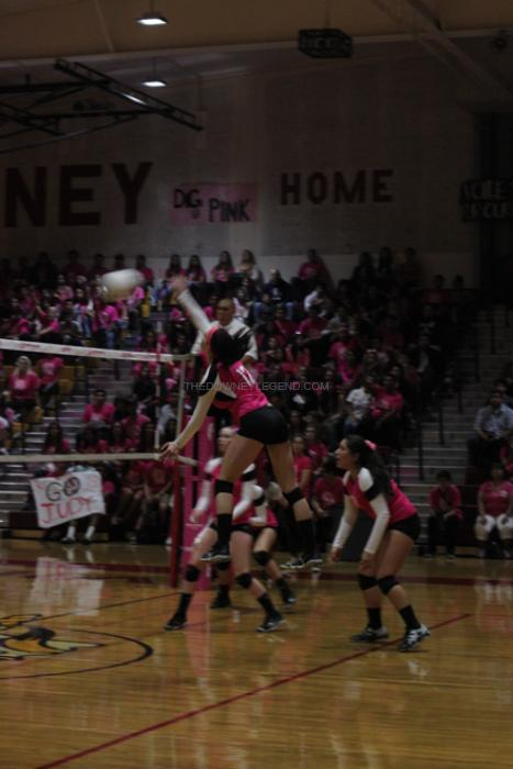 "Scoring multiple points for the Downey team, Kimberly Schnars, 11, takes part in the fourth annual Dig Pink volleyball game in the Downey High School gym. ""I feel honored to be in the presence of breast cancer survivors and I know that when I leave, I made a difference,"" Schnars said."