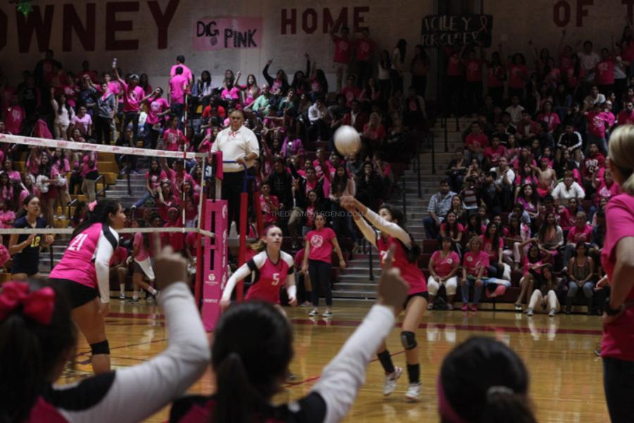Towards the end of the last set, team members and the audience hold up one finger waiting for Downey to score one last time. After winning 3 sets against the Warren Bears, the Downey volleyball players ended the last set 24 to 18.