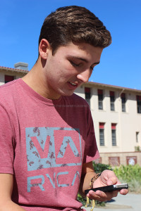 On Nov. 8, Preston Medina, 11, looks through his Vine to see how many people have posted new videos, near the bell tower. Vine was founded in June of 2012 by Dom Hofmann, Rus Yusupov, and Colin Kroll.