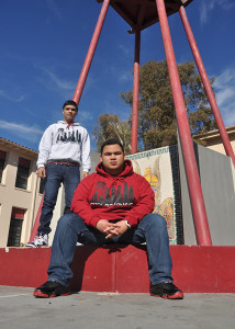 On Tues., Dec. 10, juniors Ricky Venegas and Alex Rivera, owners of LA living, show off original sweaters designs. Venegas and Rivera sold their merchandise to people around the Downey community.