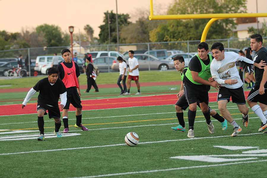 On Dec. 6, both teams competing in the soccer tournament race towards the ball to score another goal. Team Biola ended with the score of 8-2.