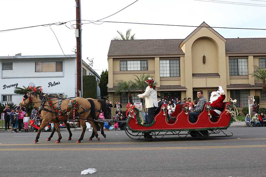 On Downey Ave., on Dec. 8, Santa Clause ends the 62nd annual Christmas Parade while riding his sleigh. The parade started at Downey and Lexington Avenues, headed to 3rd street, and then turned left to Civic Center where the show ended.
