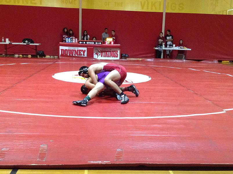 On+Wed.%2C+Dec.+4%2C+in+the+DHS+gym%2C+varsity+wrestler+Sebastian+Soto%2C+12%2C+faces+his+opponent+from+Norwalk+High+School+as+he+tries+to+pin+him.+Soto+put+Downey+in+the+lead+by+winning+his+match+with+a+score+of+22+to+6.%0A