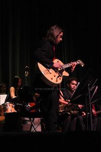 "On Wednesday, Dec. 11, senior Andrew De La Cruz performs his solo for Jazz Ensemble at the Winter Concert.  The Jazz Ensemble performed three songs: ""God Rest Ye Merry Trombones"", ""Oh, Holy Night"", and ""Perdido""."