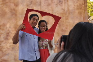 "In front of the quad, on Thurs., Feb 13, boyfriend and girlfriend Rafael Segura, 12, and Gabriela Herrarte, 12, take a polaroid together for Valentine's Day. ""I wanted to take a picture as a memory for us,"" Herrarte said."