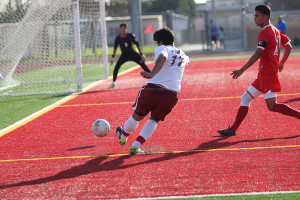 On Wed., Feb. 12, Roberto Astorga, 12, heads for the goal during the game against Dominguez High School. Downey took the win with a final score of 4 to 0.
