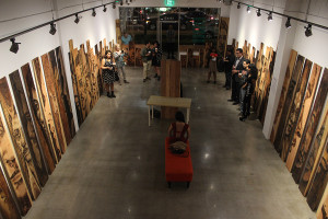 """On Fri., Feb. 14, during Zachary Aronson's first solo show at the Stay Gallery, he uses torches to draw with fire to create what is called pyrography. """"I recognize and celebrate the imperfections in the wood and in the people burnt into the wood,"""" Aronson said."""