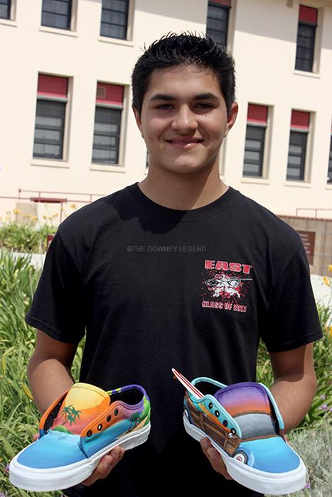 """On Thurs., May 8, freshman Giovanni Orozco, one of the semi finalists for the Vans Custom Culture contest, displays his submission,  after Ms. Nikaj entered him and six other students. """"Sometimes I wouldn't finish my work for other classes just to work on the shoes,"""" freshman Orozco said."""