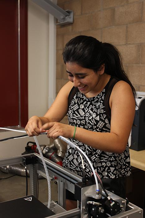 "Every Wednesday afterschool, Warren High School transfer, Daniela Figueroa, 12, works on building a reading printer, in her engineering class, for the school to use. ""All these new engineering classes are the only reason why I moved to Downey High School,"" Figueroa stated."