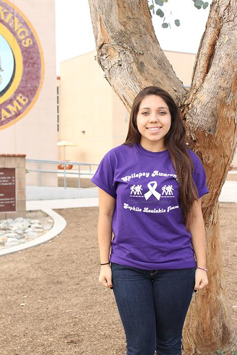 "Promoting a walk for epilepsy, on Nov.11, Sophia Loulakis, 12, wears her shirt to encourage awareness of the neurological disorder she's been battling for five years and now. ""I want to make sure everyone is aware, and that it's not a joke,"" Loulakis said.  ""Cancer may kill but so does epilepsy."""