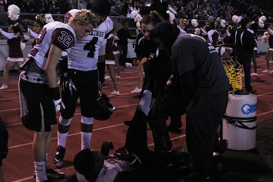 """During the CIF game on Dec. 5, Michelle Avedissian is quick to act when player, Darrian Franklin, 11, is injured on the field, and both Kiefer Enslin , 11, and  Camercon Carr, 11, watch over him to make sure he is ok.  """"Coach A is a very nice and cool person,"""" Franklin stated. """"She helped me when both of my legs cramped up during the game."""""""