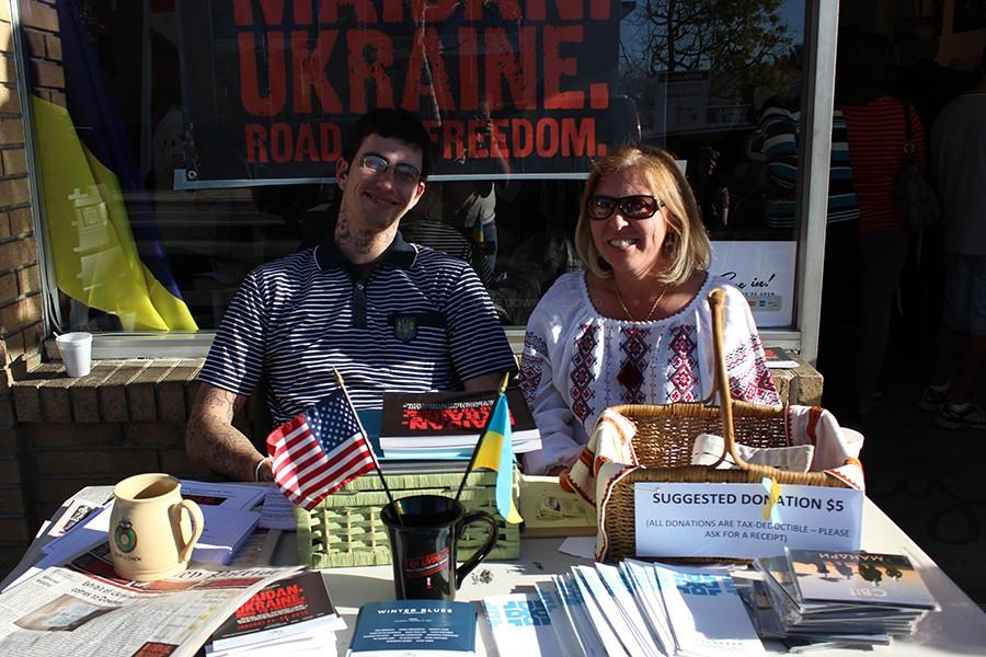Zoryana+Keske+and+Vaughn+Lewis+sit+outside+of+Stay+Gallery+in+Downey%2C+on+Jan.+24%2C+to+support+their+event+of+Maidan.+Ukraine.+Road+to+Freedom.+%E2%80%9CThis+is+for+the+Ukrainian+people%2C%E2%80%9D+Keske+said%2C+%E2%80%9Cwho+right+now+are+fighting+for+their+freedom.%E2%80%9D