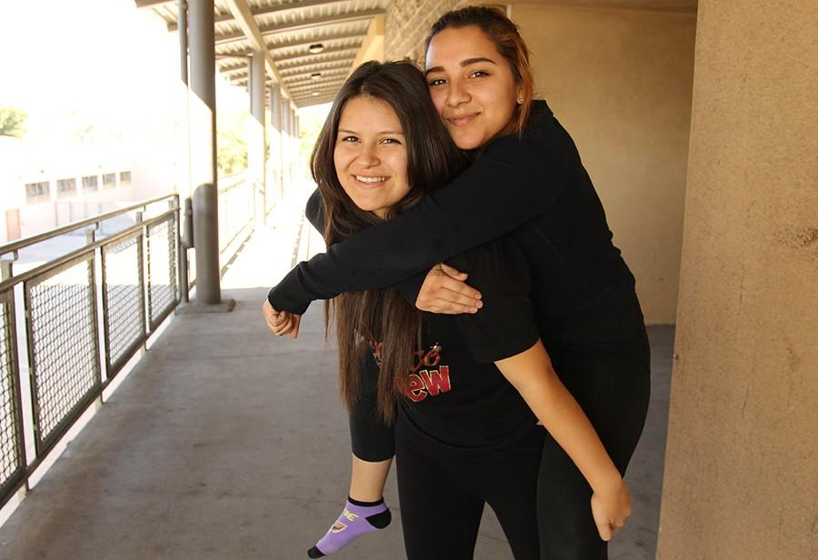 """New to the Downey High School campus, Stephanie Gonzalez meets her first and best friend, senior Marlene Oropeza, in her ROP dance class during the first week. """"At first it was overwhelming because I didn't know anyone, but I love the friends that I've made and the people I've met,"""" Gonzalez stated."""