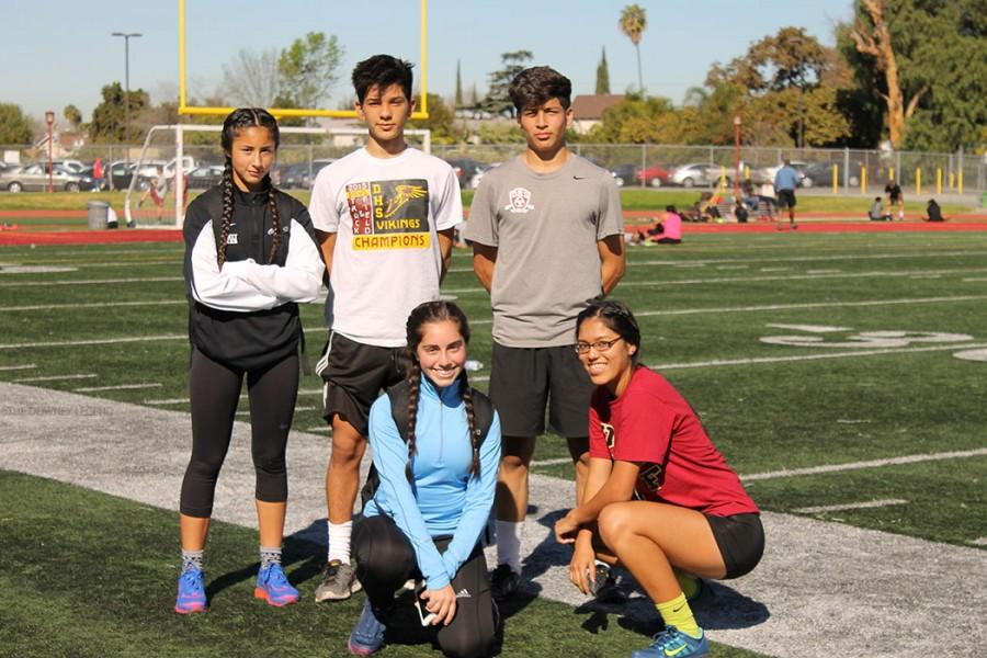 At+the+all-comers+meet+on+Jan.+24%2C+Stephanie+Puga%2C+11%2C+Julian+Briseno%2C+12%2C+Bryan+Majano%2C+12%2C+Yasaman+Peyvandi%2C+11%2C+and+Joselyn+Alejos%2C+11%2C+pose+at+the+track.+%E2%80%9CWe+come+out+here+to+have+fun+and+work+hard%2C%E2%80%9D+Briseno+said.++%E2%80%9CAnything+is+more+fun+with+friends.%E2%80%9D