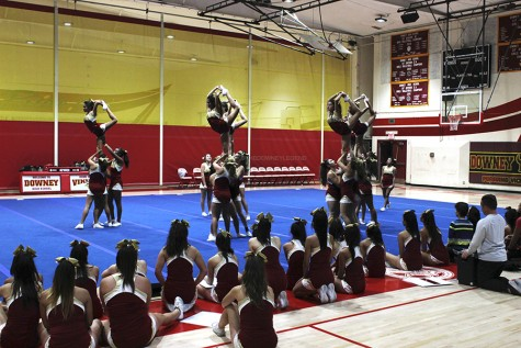"In the gym on Jan. 19, the varsity cheer team's flyers practice their scorpions for their competition in Dallas, Texas. ""We are not use to this kind of routine; it's different,"" Avrion Gray, 12, said. ""There are a lot of things going on."""