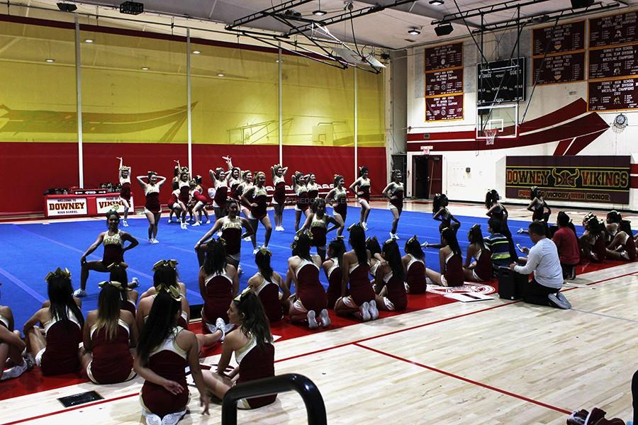 """On Monday night, Jan. 19, the varsity cheer team practice their routines to be ready for their competition in Dallas. """"I think this whole practicing at night is worth it; we hope to come back with some jackets,"""" Avrion Gray, 12, said."""