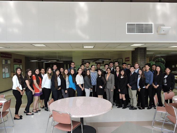 At the Sanitation District of Los Angeles County, on Jan. 31, the Young Legislators pose with Assemblymember Cristina Garcia after their lunch break. The students listened on as Garcia gave them a run down of how her life as a legislator was going.