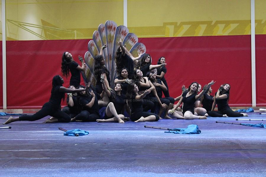 "The varsity colorguard team performs their 2015 winterguard show titled, Aphrodite on Feb. 8 in the gym. ""Performing is fun because you get to be with your friends,"" Roa stated."