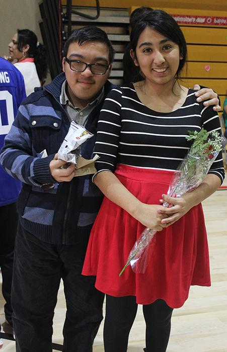 During the Amigos' Valentine's Day dance, on Feb. 12, sophomore Raven Perez unexpectedly receives a red rose from Luis Zavala, 10.  This gesture showed the close bond between the Amigos members.