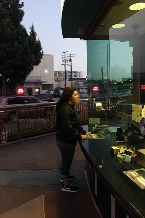 """On Feb. 6, Alejandra Mendez, 11, purchases her ticket for The Spongebob Movie: Sponge Out of Water at the Downey Kirkorian Theatre. """"Buying this ticket was like buying a ticket back to my childhood,"""" Mendez said."""