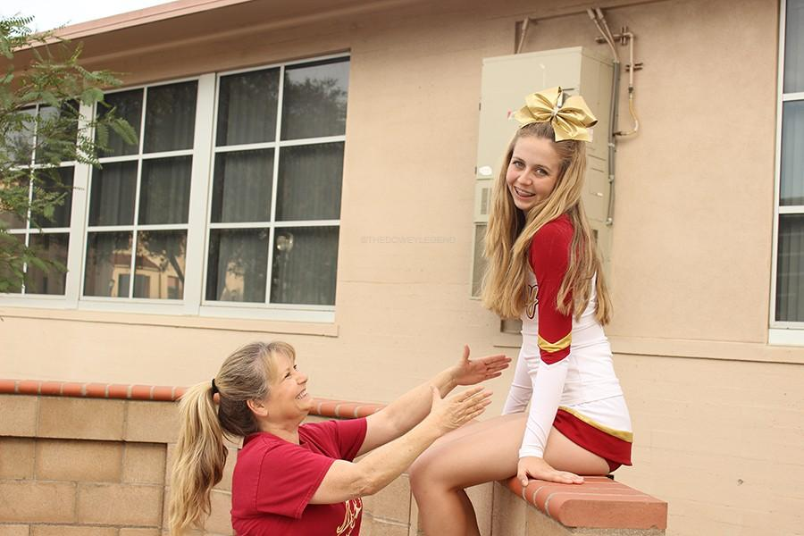 Cheerleader+Mikayla+Minnig%2C+11%2C+and+her+mom+Mrs.+Minnig%2C+have+a+brief+mother+and+daughter+time+around+the+Downey+High+school+campus+on+Mar.+16.+%22Between+cheer+and+homework%2C+we+spend+a+good+portion+of+our+time+volunteering+for+the+Arthritis+Foundation%2C+since+Mikayla+has+Juvenile+Arthritis%2C%E2%80%9D+Mrs.+Minnig+said.+%E2%80%9CI+am+really+proud+to+be+a+%22Cheer+Mama%22+and+will+support+my+daughter+in+all+of+her+adventures+in+life.%22+