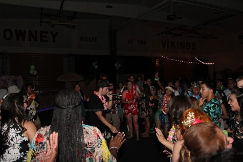 "At the Downey High School gym on April 17, the Sadie's DJ interacts with students attending the dance to get the crowd hyped up. "" The DJ was awesome, [I] love how he came down and hyped us up,"" senior Destiny Ayala said."