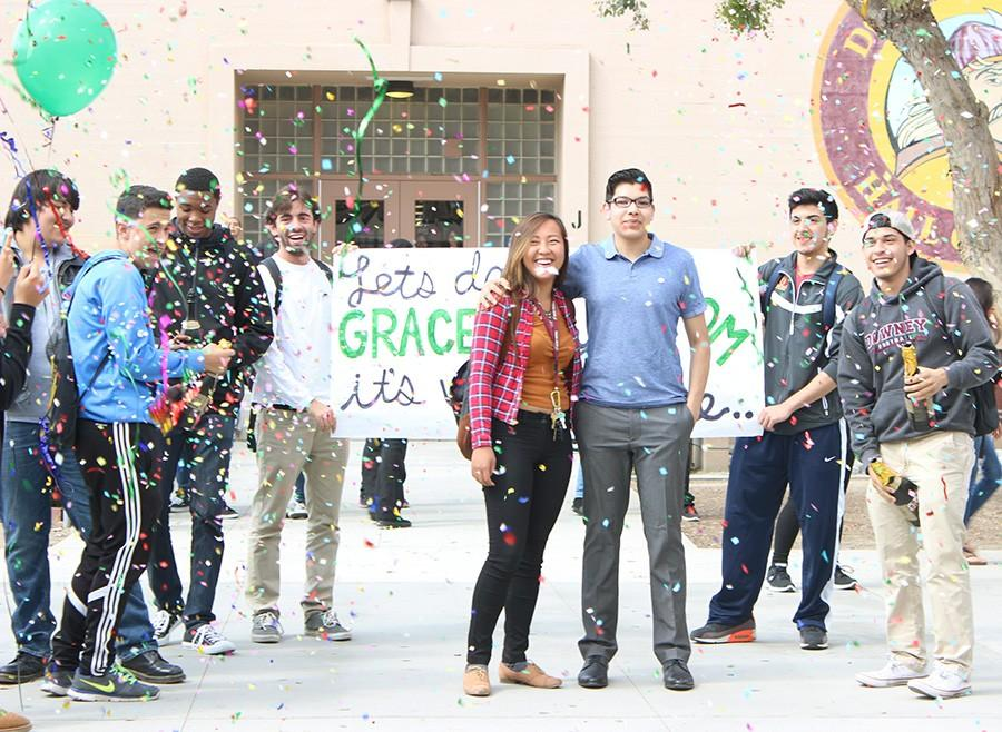 Senior+Jaime+Garcia+asked+senior+Grace+Choi+to+prom%2C+on+May+22+at+snack%2C+using+green+balloons+to+symbolize+the+green+light+featured+in+The+Great+Gatsby%2C+which+ties+into+this+years+prom+theme%3A+The+Roaring+20s.+%E2%80%9CIt+took+a+lot+of+planning+and+thinking+in+order+to+get+everything+perfect%2C%E2%80%9D+Garcia+said%2C+%E2%80%9Cbut+at+the+end+of+the+day%2C+it+was+all+worth+it.%E2%80%9D