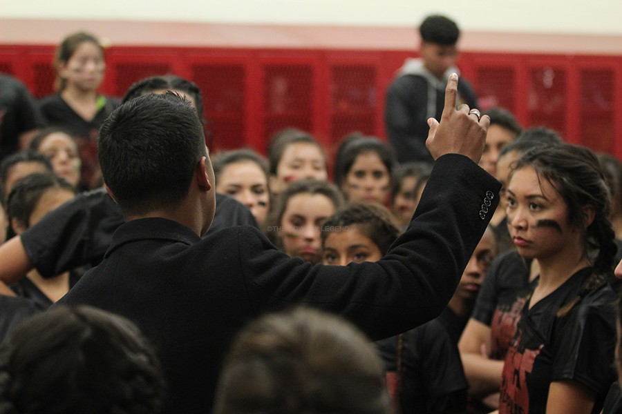 """During half time at the Powder Puff game, still with no score on the scoreboard, Head Coach Eduardo Preciado, 12, talks to the senior team in the locker room. """"For my last year here, it was great,"""" Preciado said. """"I love leading my warriors."""""""