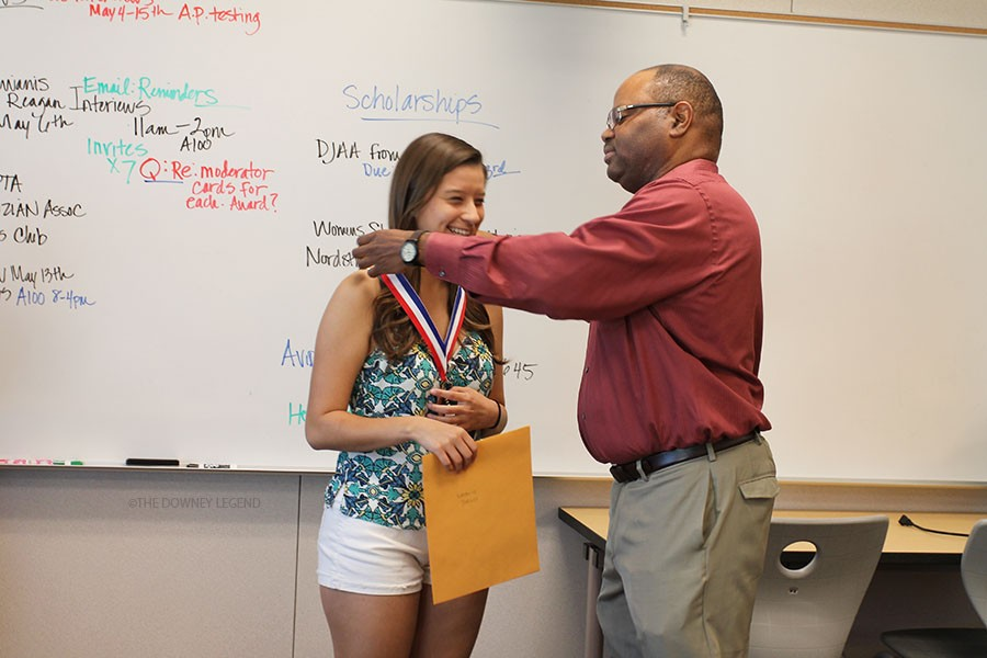 """In honor of her work for the Los Angeles County Regional Occupational Program, Natalie Turcios, 12, receives her silver medal from counselor, Mr. Frye on April 28. """"We had to present to the judges what we learned in our CTE class, and for me it was health occupations,"""" Turcious said.  """"I showed how it motivated to pursue a career in the field of medicine."""""""