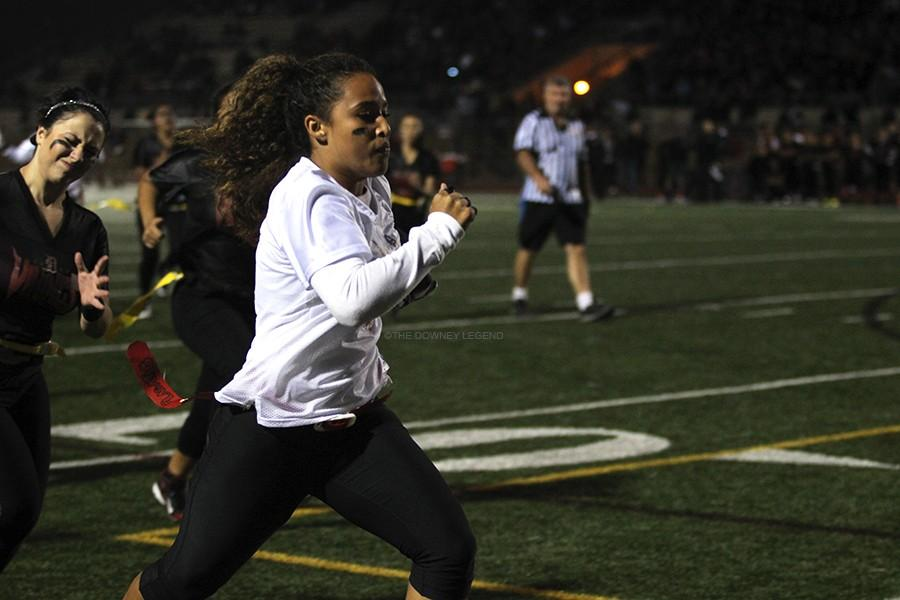 """On Friday, May 8, Danniela Da Silva, 11, makes a touch down for the juniors at Allen Lane Stadium during the fourth quarter at the Powder Puff game. """"When I was running, I felt like no one can stop me and I made sure I came through for my team,"""" Da Silva said. """"After I scored, I was glad to contribute to a great game."""""""