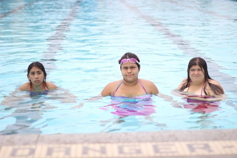 """At Downey High's pool, on June 3, seniors Haley Lueanos, Miriam Castillo and junior Raven Perez, take a swim for the final Amigos Club BBQ of the school year. """"The pool party was really fun,"""" Castillo said. """"It was a great time and very relaxing."""""""