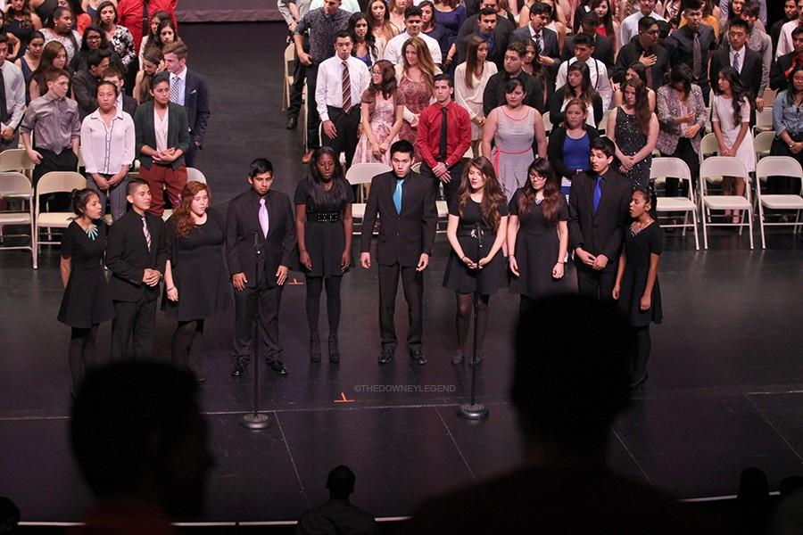 On June 8, at the Senior Awards night in the Downey Civic Theatre, Downey High Schools Jazz Choir perform the National Anthem to start the night off. While performing, all parents, teachers, and seniors stood up to show their respect.