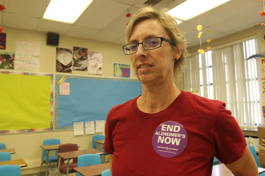 With a mother struggling through Alzheimer's disease, Mrs. Kasner raises awareness by wearing an Alzheimer's sticker in S-2. Kasner sells these stickers for only $1.