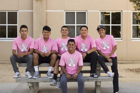 """To show support, for Breast Cancer Awareness Month, this October, Kyle Vasquez, 11, and his baseball teammates sport their """"Team Emma"""" shirts for Vasquez's mother who is currently battling breast cancer. """"We're a team,"""" Arnulfo Serrano, 11, said. """"It's family."""""""