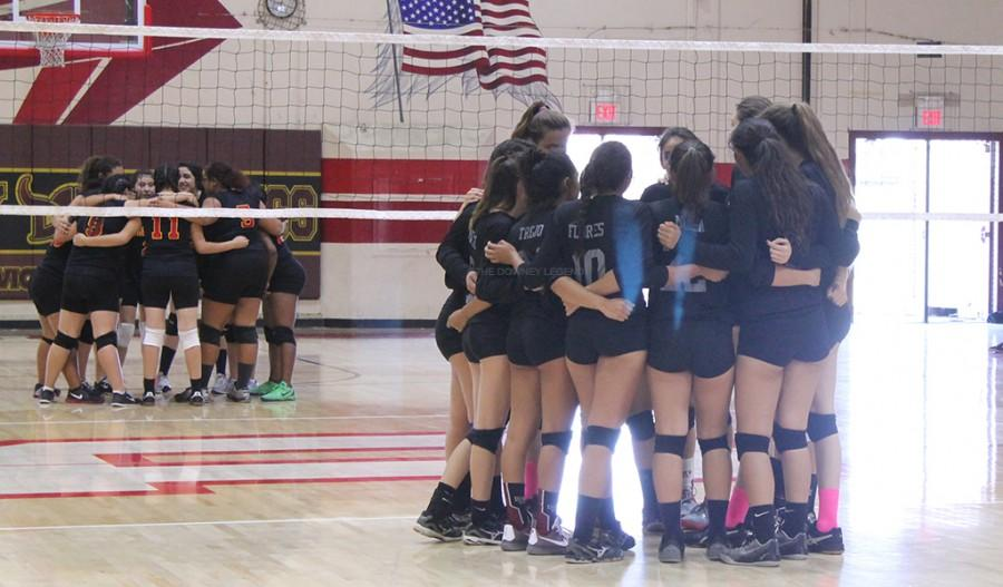 "The girls varsity volleyball team does a quick huddle before their game vs. Dominguez in the DHS gym on Tuesday, Oct.19. ""I feel like we did very good as a whole team by holding them at only a couple of points,"" Destiny Gomez, 11, said. ""We didn't let them bring us down."""