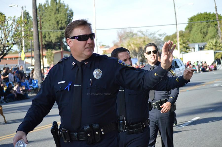 Captain Dean Milligan, along with other officers, stop to socialize with citizens on the street. The majority of the officers came out to the parade to pay respects to their fallen hero.