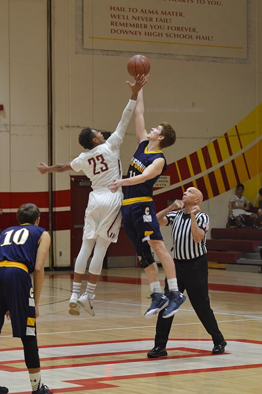 "As the basketball game for Downey begins against Cal High, C.J. Smith, 12, goes up for the jump ball on Jan 5. ""It doesn't matter if you win or lose as long as you give everything in your heart,"" Smith said."