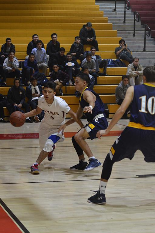 """Driving down the baseline to score for his team, Justin Tejeda, 11, passes the defender to go to the basket on Jan 5. """"Don't get satisfied [with your performance],"""" Tejeda said. """"When you leave your guard down, you let your team down."""""""