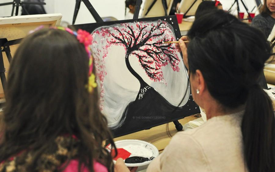 """Darella Chavez and her daughter Ava Lucia Chavez both created unique pieces of art at the Stay Gallery's Paint and Cookies event on February 12. """"I liked the tree because it was really pretty,"""" Ava Lucia Chavez said when asked if she liked her painting and approved of the painting assignment."""