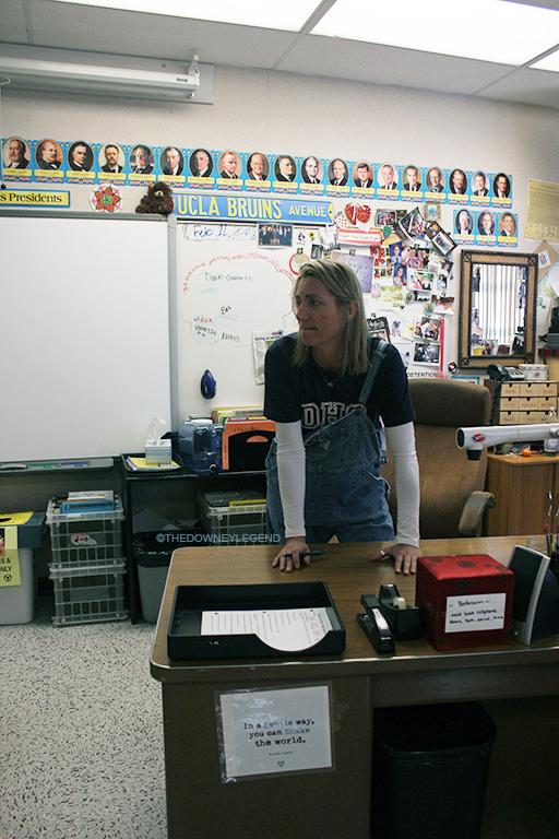 In B-212, after school on Feb. 12 Ms. Rabak waits to sign her students' Great Depression Challenge papers. The challenge takes place over the course of two weeks and participants must wear the same outfit everyday.