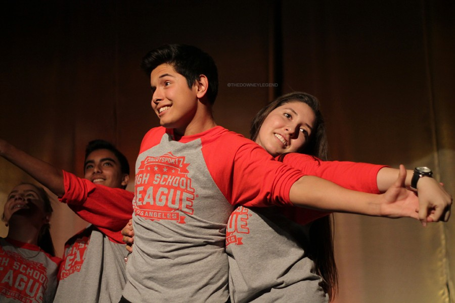 "Comedy Sportz, the interactive game-show is broadcasted in the Downey High School theater where red team player, senior, Ryan Gutierrez, reenacted a dancing couple in love with fellow teammate, senior, Beatrice Medina. ""Now that I'm on the team, it feels amazing being a part of something I didn't know about at first but now see how big of a world Comedy Sportz is,"" Gutierrez, said."