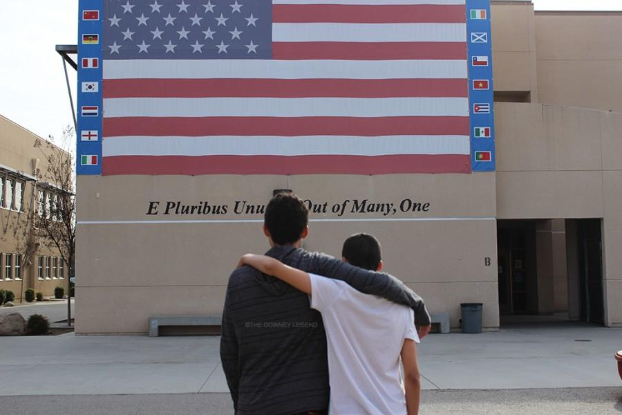 On Friday, Feb. 26, sophomore Juan Gonzales and Morad Daachi engage in a brotherly embrace in front of the American flag to demonstrate their fondness of one another. The foreign exchange students shadowed their hosts for a total of two weeks, between Feb. 20 through March 5, as an assignment for the French II class.
