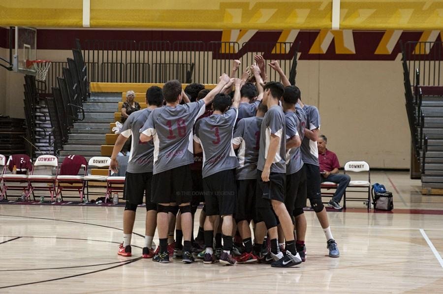 Eager to beat the Warren High Bears, the varsity boys volleyball team gets pumped on April 26 in the Downey High gym. The Vikes played well ending the first match 22-25.
