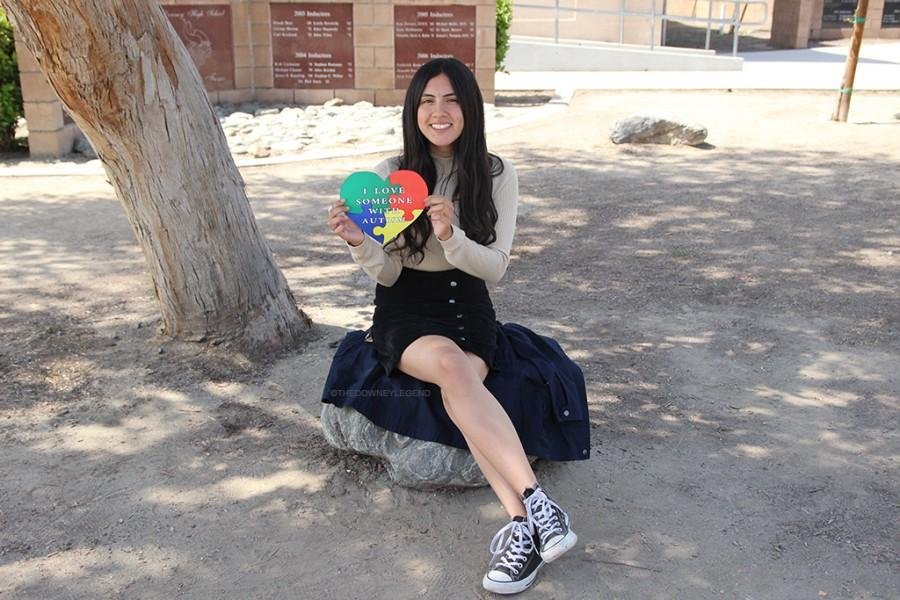 """Estefania Pena, junior, proudly exhibits her love and appreciation for autism because someone special to her has autism, her younger brother, Celso. """"My brother is my best friend. He literally makes me so happy,"""" Pena said. """"I wish people knew more about autism, instead of giving them a bad face; people should recognize that they're human just like you and I."""""""