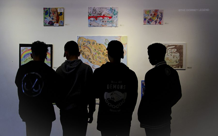"Warren High student, Jamie Murry stops by to see what new events are exhibited at the Stay Gallery with his friends. ""I like to see what people do on their spare time,"" Murry said. ""It's cool to see what other people can do."""